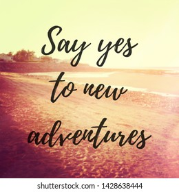 Quote - Say yes to new adventures with a beach background