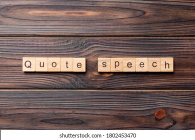 quote speech word written on wood block. quote speech text on cement table for your desing, concept.