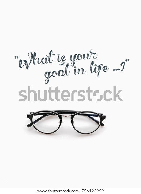 "Quotes of ""What is your goal in life?"" with eyeglasses on white background."