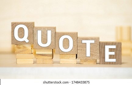 Quotes - word from wooden blocks with letters, citation official notice or quotation concept, grey background