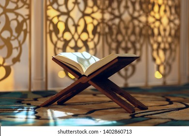 Quran is holy book of islam open for reading in a mosque