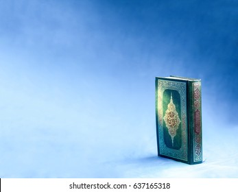 Quran or Kuran, the islamic holy book, in dark background