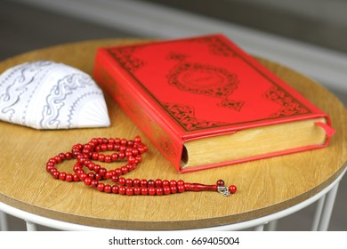 Quran, muslim hat and rosary beads. Quran is holy book religion of Islam