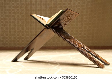 Quran on a wooden stand. Quran is holy book religion of Islam
