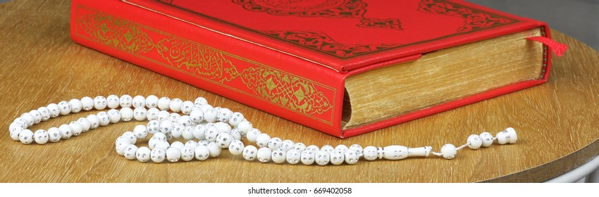 Quran and rosary beads. Quran is holy book religion of Islam