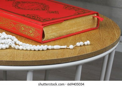 Quran and rosary beads . Quran is holy book religion of Islam