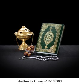 Quran With Rosary, Censor and Dates Over Black Background