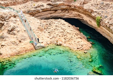 Qurayyat, Oman - August 13, 2018: Bimmah Sinkhole in eastern Muscat Governorate, Oman. It is 50 m by 70 m wide and approximately 20 m deep.