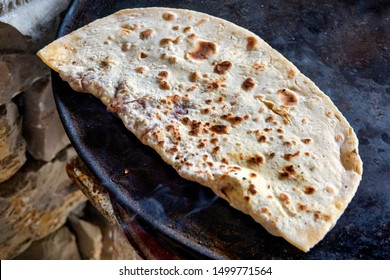 Qutab, an Azerbaijani dish made from thinly rolled dough ,cooked briefly on a convex griddle known as saj.