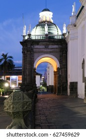 Quto Cathedral entrance at twilight with lights on