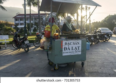 QUY NHON, VIET NAM - MAY 15, 2017: People sale grill paper rice in sunny
