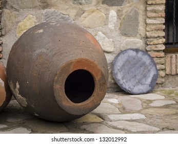 A Qvevri is a large earthenware vessel originally from Georgia, Caucasus. It is used for the fermentation and storage of wine, often buried below ground level or set into the floors of wine cellars.