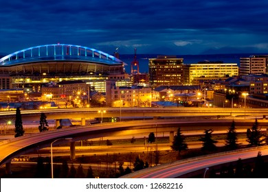 Qwest Field arena and interstate I-5 at night in Seattle, Washington