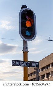 R. Mugabe Street sign and traffic lights in Bulawayo City, Zimbabwe
