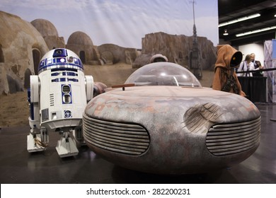 R2D2 with a land speeder and a Jawa on display at the Star Wars Celebration in Anaheim, California, April 2015.