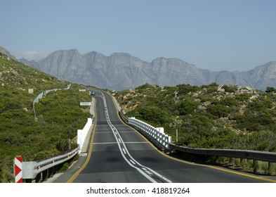 THE R44 HIGHWAY WESTERN CAPE SOUTH AFRICA - APRIL 2016 - Bridge over the Steenbras River on the R44 Clarence Drive close to Gordon's Bay and the Hottentot Mountains in the Western Cape South Africa
