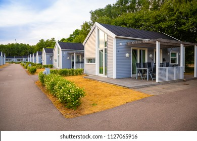 Raa, Sweden - 17.06.2018: Group of similar grey camping cabins in small swedish town Raa, Sveden