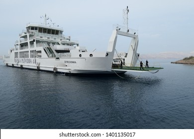Rab Croatia April 10th 2019 white ferry on the adria sea as boat for the people and cars