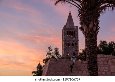 Rab Island, Croatia - 10 August 2018 - Church tower on Rab Island in Croatia, at sunset.