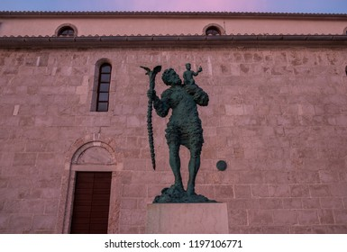 Rab Island, Croatia - 10 August 2018 - Statue of Saint Christopher next to the Cathedral of the Holy Virgin Mary's Assumption on Rab Island in Croatia.