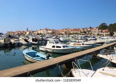 Rab, Rab island, Croatia - July 19, 2018: Marina and cityscape of the  old town of Rab on the island Rab, Croatia. South-East Europe.