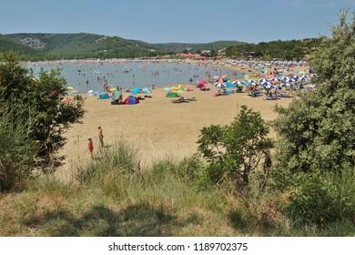 Rab island, Croatia - July 19, 2018: The Paradise beach in Lopar, Croatia. South-east Europe.