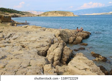 Rab island, Croatia - July 19, 2018: Sea and bizarre rock formations on Rab island, Croatia. Near the town Lopar and Livacina beach. South-east Europe.