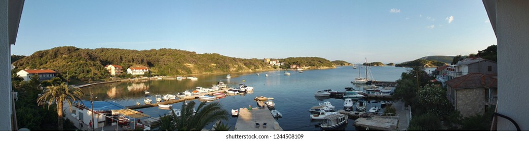 Rab island, Croatia - July 21, 2018: Panorama picture of the bay  of Supetarska Draga, a quiet place on Rab island. Seen from a hotel's balcony. South-east Europe.