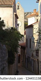 Rab, Rab island, Croatia - July 21, 2018Alley with historic clock tower in the old town of Rab on Rab island, Croatia. South-East Europe.