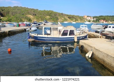 Rab island, Croatia - July 22, 2018: Boats in the bay of Supetarska Draga, a quiet place on Rab island.  South-east Europe.