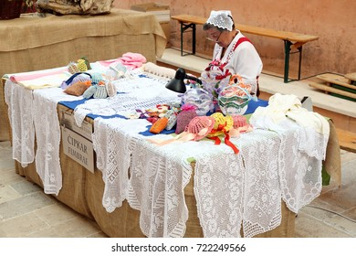 Rab, Rab Island, Croatia - July 27, 2013: An old woman selling handmade products from Rab lace during Rab Fiera.