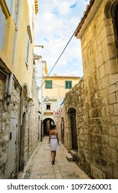 Rab Island, Primorje-Gorski Kotar / Croatia - 28 08 2014: View on a narrow street on island with tourist walking and small souvenir shops and restaurants , tourist spot place to see.