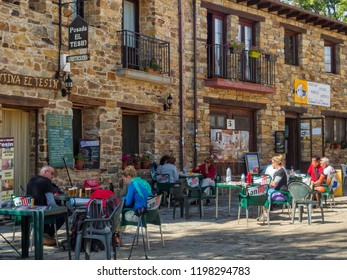 Rabanal del Camino, Castile and Leon, Spain - September 24, 2014: Camino pilgrims have a rest, some drinks and food at the La Senda Hostel