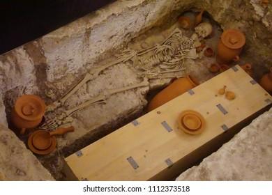 RABAT, MALTA - APR 19, 2018 - Skeleton in a tomb in the Catacombs of St Paul, Rabat, Malta