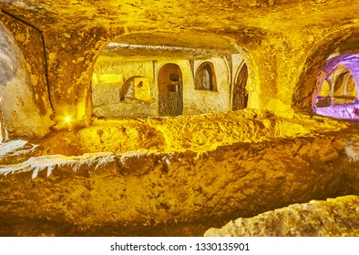 RABAT, MALTA - JUNE 16, 2018: Interior of burial chambers of ancient St Cataldus catacombs with small chambers and numerous grave niches, on June 16 in Rabat.