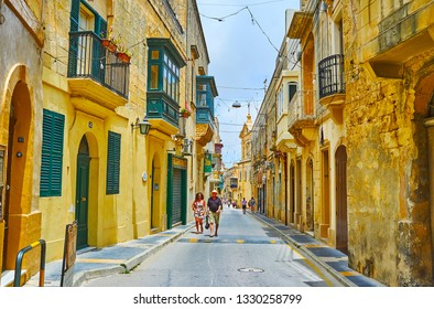 RABAT, MALTA - JUNE 16, 2018: Walk historical  St Paul street, lined with old residential edifices, tourist shops and churches, on June 16 in Rabat.