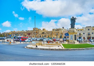 RABAT, MALTA - JUNE 16, 2018: The Museum square of Rabat is decorated with monument of St Joseph, surrounded by the small flower bed, on June 16 in Rabat.