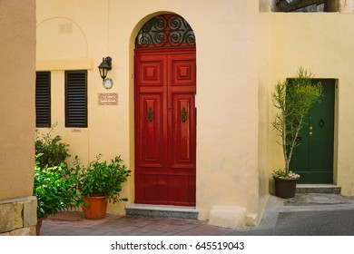 Rabat, Malta - March 10 2017: Facade of traditional maltese house in Rabat with massive wooden doors and house's nameplate, Malta