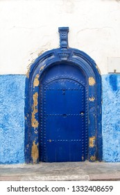 Rabat, Morocco - February 22, 2019: Traditional Moroccan door with arch form painted with blue in Kasbah of the Udayas.