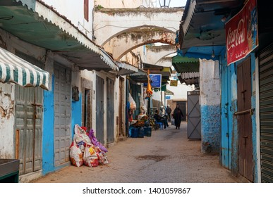 RABAT, MOROCCO - FEBRUARY 22, 2019: Narrow street with shops and blue and white painted houses in the old Rabat medina.