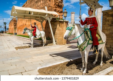 RABAT / MOROCCO - MARCH 20, 2018: Royal guard in front of Hassan Tower and Mausoleum of Mohammed V. Mausoleum contains tombs of late King Hassan II and Prince Abdallah. March 20, 2018 in Rabat,Morocco