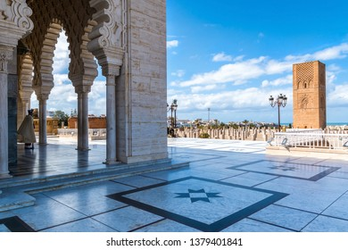 RABAT / MOROCCO - MARCH 20, 2018: Beautiful Mausoleum of Mohammed V and square with Hassan tower in Rabat on sunny day. March 20, 2018 in Rabat, Morocco
