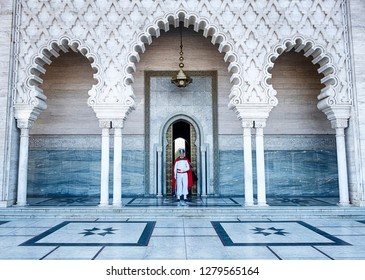 RABAT, MOROCCO - OCTOBER 21, 2018: A member of the Royal Guard in ceremonial uniform stands at attention at an entrance to the Tomb of Mohammad V in Rabat, Morocco.