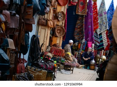 Rabat, Morocco - October 25, 2018: Old merchants sitting on the street with their traditional goods for sale