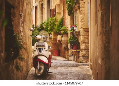 RABAT/MALTA - November 21, 2017: Cozy street in old Rabat with a lonely motorcycle
