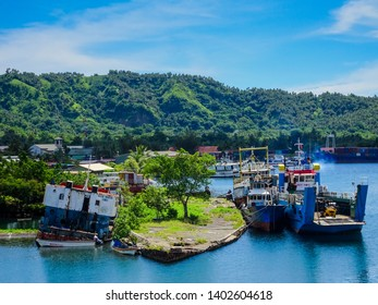 Rabaul, New Britain, Papua New Guinea - February 24 2017: At the end of WWII, the Seabees sank a Japanese ship & filled it with concrete to make a wharf. Now overgrown, it is still used by local boats
