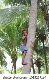 Rabaul, Papua New Guinea - April, 2016 - Young Boy with bird on his head, giving thumbs up to visitors to his village (Matupi)