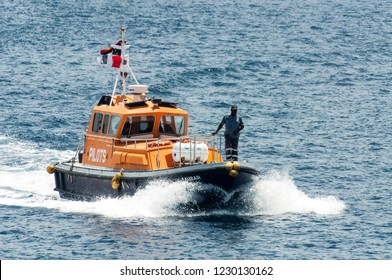 Rabaul, Papua New Guinea - April 16 2014: The pilot boat speeds out to the port limits, to put a harbor pilot on board an arriving ship.