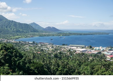 Rabaul / Papua New Guinea - July 7, 2019: panoramic view of the bay in front of Rabaul with the jungle, the city, the sea and Tavurvur volcano in the background
