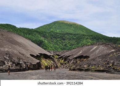 RABAUL, PAPUA NEW GUINEA - MARCH 9, 2014: Local kids exploring area near Tavurvur volcano, Rabaul, New Britain island, Papua New Guinea on March 9, 2014.